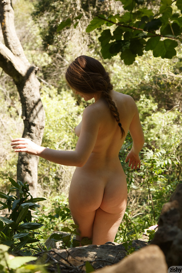 Texas redhead Misty Lovelace exposing hairy pussy on the nature trail